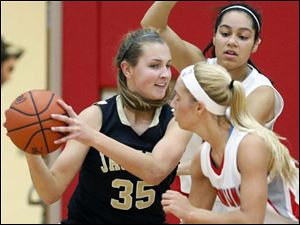 Perrysburg's Allex Brown (35) tries to to get past  Bowling Green's Tyanna Smith (15) and Hanna Williford (21).