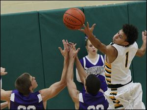 Clay's junior guard Patricc Both gets his fingers on a rebound against Fremont Ross.
