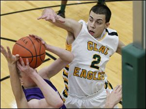 Clay's senior guard Jack Nagy attempts to block an opponent's layup.