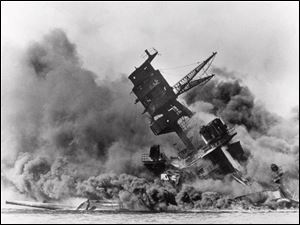 Smoke rises from the battleship USS Arizona as it sinks during a Japanese surprise attack on Pearl Harbor, Hawaii.