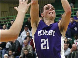 Fremont Ross' senior guard Alex Metcalf goes in for a layup.