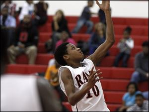 Kevon Davis, of the Rogers Rams, makes a layup.