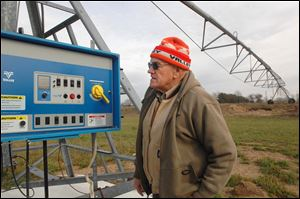Chuck Phillips, co-owner of Phillips & Son Irrigation Services in Bristol, Ind., shows a control panel at a pivot point on a three-span irrigation system. The company is busy installing and expanding the equipment throughout the region. Business has doubled this year, Mr. Phillips said.