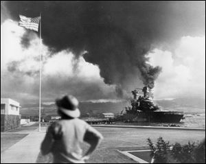 American ships burn during the Japanese attack on Pearl Harbor, Hawaii.