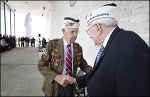 Pearl Harbor survivors Max Green, left,  and Bill Thornton greet each other prior to the Pearl Harbor Day Remembrance Ceremony at the Va. War Memorial, in Richmond, Va. on Friday.