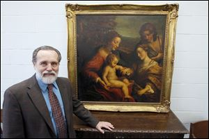 Goodwill of Northwest Ohio CEO Bob Huber shows the 1823 painting that sold for $19,103.