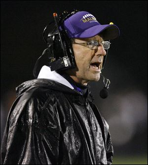 Maumee high school head coach John Boles yells to his team during the second quarter against Sylvania Southview in 2008.