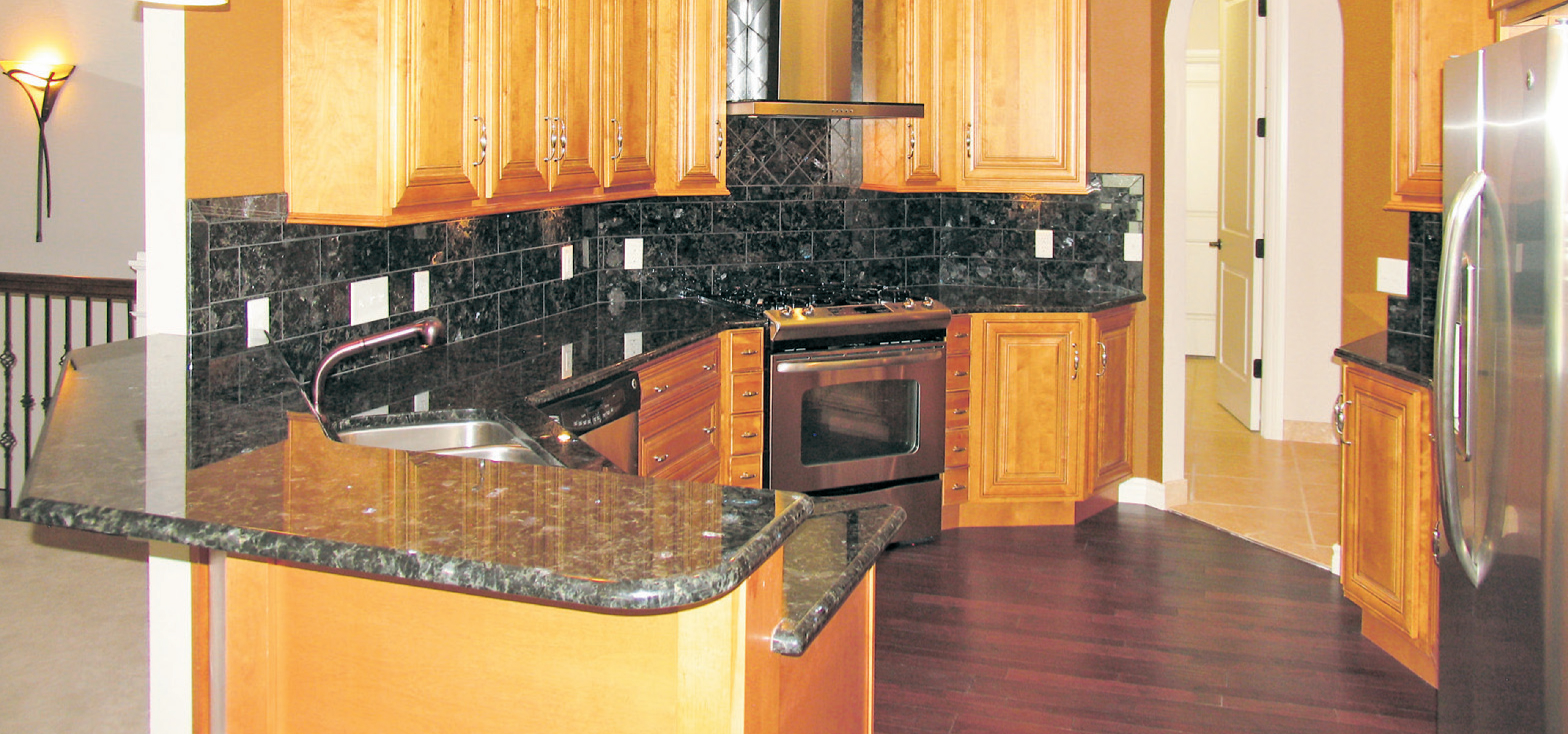 Exquisitely Finished: Home Features Marble, Granite And ... on Maple Cabinets With Black Granite Countertops  id=46415
