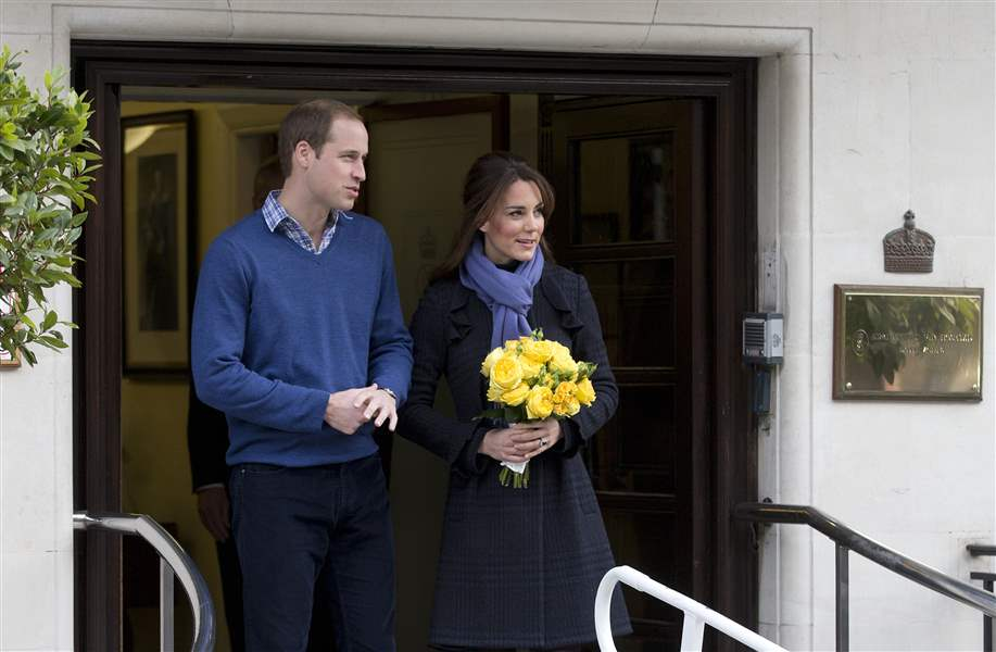 Britain-s-Prince-William-stand-next-to-his-wife-Kate-2