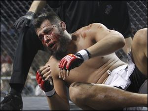 A bloodied Hector Urbina stands up after the referee stops the fight due to blood at the Purgatory Fight Series 10 event.