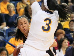 UT's Lucretia Smith tries to block the lane of her defender.