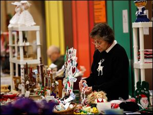 Sharon Dietrich, of Monclova, organizes her crocheted