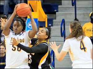 UT's Brianna Jones looks to pass after getting a defensive rebound.