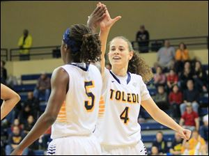 Naama Shafir, right, congratulates teammate Janelle Reed-Lewis who hit a three point shot while being fouled.