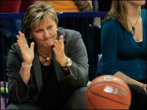 UT coach Tricia Cullop applauds her team.