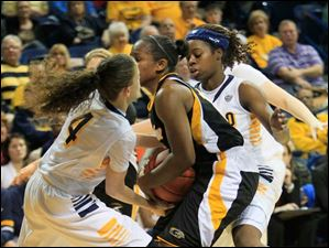 UT's Naama Shafir gets her hands on the basketball on defense.