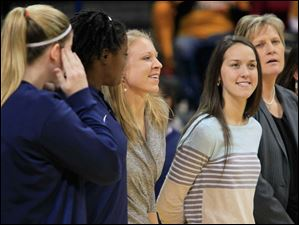 UT players Kyle Baumgartner, left, and Brianna Jones, are joined by former Rocket Haylie Linn as UT recognizes last year's Mid-American Conference West Division co-championship squad. Linn is now a graduate assistant with the University of Wisconsin-Milwaukee. Also pictured are Jessica Slagle, graduate assistant to UT, and head coach Tricia Cullop.