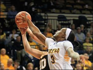 UT's Lucretia Smith lunges for a rebound.