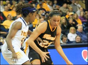 UT's Janelle Reed-Lewis jars the ball loose on defense.