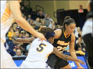 UT's Janelle Reed-Lewis gets one of four steals.