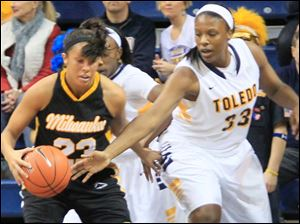UT's Yolanda Richardson taps the ball away on defense.