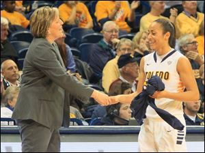 UT coach Tricia Cullop congratulates Inma Zanoguera after Zanoguera finished with 12 points, had four rebounds, three steals, two assists, and one block with no turnovers.