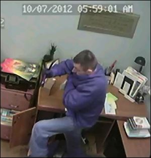 A surveillance camera caught this man apparently burglarizing a church in Lenawee County. Authorities say 50 churches in nine counties have been robbed.