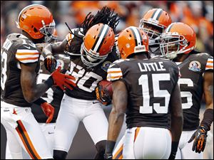 Cleveland Browns wide receiver Travis Benjamin (80) is congratulated by teammates after a 93-yard punt return for a touchdown in the second quarter of Sunday's against the Kansas City Chiefs in Cleveland.