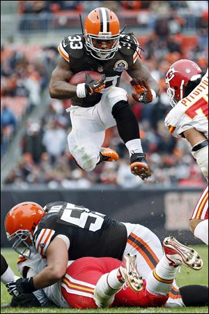 Browns running back Trent Richardson leaps over the line during the third quarter against the Kansas City Chiefs on Sunday in Cleveland. The Browns won 30-7.