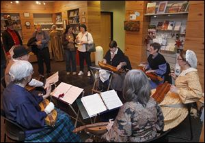 The Back Porch Dulcimer Band plays holiday music as visitors tour Fort Meigs in Perrysburg.