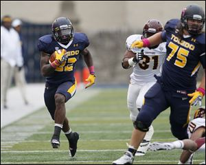 Toledo running back David Fluellen races up the sideline for a first down against Central Michigan during a 50-35 victory on Oct. 6 at the Glass Bowl. The Rockets are one of seven Mid-American Conference teams that will appear in the postseason.