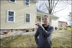 Dori Durbin says royalties from the wells across the street from her Adrian Township home are helping.