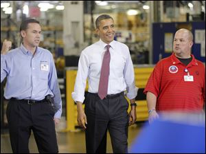 "President Barack Obama walks with Plant Manager and Vice President of Operations Jeff Allen, left, and UAW NW Local 163 Detroit Diesel Engine Unit Shop Chairperson Mark ""Gibby"" Gibson, right, during a visit to the Daimler Detroit Diesel plant in Redford, Mich."