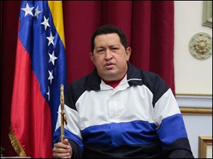Venezuela's President Hugo Chavez holds a sword that once belonged to independence hero Simon Bolivar at a meeting with his Cabinet, at Miraflores Presidential palace in Caracas, today.