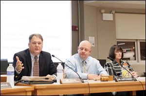 Oregon Superintendent Michael Zalar, left, says reconfiguring grades five through eight would address  underperforming  classes. With him are board members P.J. Kapfhammer and Carol-Ann Molnar.
