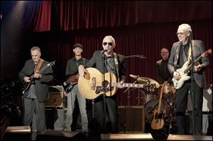 Graham Parker, center, appears in a scene from the Universal Pictures film, 'This is 40,'  written, co-produced and directed by Judd Apatow.