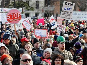Demonstrators protest against right to work legislation at the Michigan State Capitol.