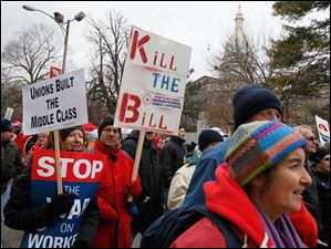 Demonstrators protest against right to work legislation in Lansing, Michigan.