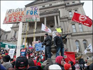 Demonstrators protest on the steps of the state capital building in Lansing, Mich., against right-to-work legislation.