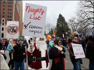 'Santa' proclaims Michigan Gov. Snyder has landed on his naughty list.