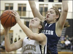 Perrysburg's Alexx Brown (35) goes to the net against  Napoleon's Lindsay Ferguson (30).