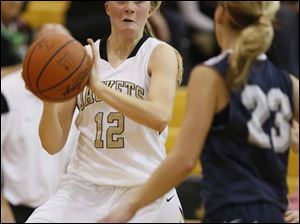 Perrysburg's Maddy Williams (12) steals the ball.