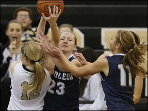 Perrysburg's Maddy Williams (12) battle Napoleon's Alexa Sonnenberg (23) and Sydney Lawson (11) for the ball.