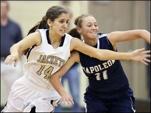 Perrysburg's Katie Dunphy (14) and Napoleon's Sydney Lawson (11) chase a loose ball.