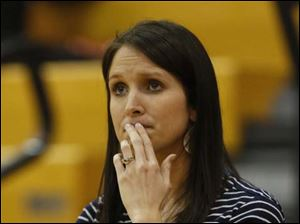 Napoleon girls basketball coach Kara Miller watches the action.