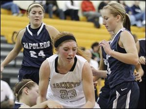 Perrysburg's Sarah Baer (23) battles  Napoleon's Lindsay Ferguson (30) for the ball.