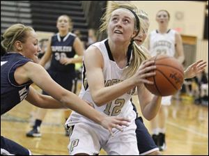 Perrysburg's Maddy Williams (12) looks for an opening against Napoleon.