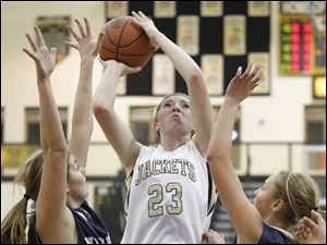 Perrysburg's Sarah Baer (23) goes to the net against Napoleon's Amberly Miller (24) and Sydney Lawson (11).