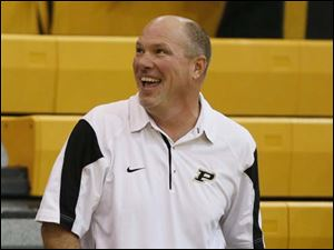 Perrysburg girls basketball coach Todd Sims smiles.