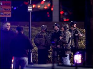 Law enforcement personnel work the scene of a shooting at the Clackamas Town Center in Clackamas, Ore.